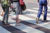 People crossing a road at the pedestrian crossing — Stock Photo