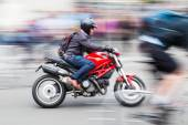 Motorcyle on the road in motion blur — Stock Photo