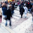 Crowds of people in motion blur in the city — Stock Photo #55119909