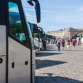 Tourist buses in a row — Stock Photo