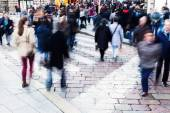 Crowds of people in motion blur in the city — Stock Photo