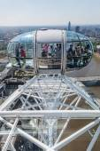 People in a capsule of the famous London Eye in London, UK — Stock fotografie