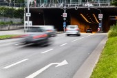 Road traffic in motion blur leading in a tunnel — Stock Photo