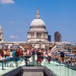 Millennium Bridge in London with the St Pauls Cathedral in the background — Stock Photo #55207563