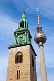 Berlin Radio Tower against an old church in Berlin, Germany — Stock Photo