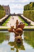 Golden sculptures in the gardens of the Palace of Versailles — Stock Photo
