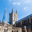 Old church with the famous The Shard skyscraper behind in London, UK — Stock Photo #55347991