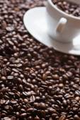 Coffee beans and a coffee cup — Stock Photo