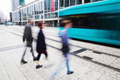Street view of the financial district in Frankfurt, Germany, with tram and people in motion blur — Stock Photo