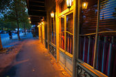 Typical night street with closed shops and restaurants in Paris, France — Stock Photo