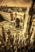 View from the Milan Cathedral on the Cathedral square in a vintage style processing — Zdjęcie stockowe