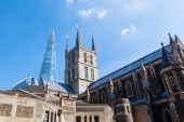 Old church in contrast to the modern skyscraper The Shard in London, UK — Stock Photo