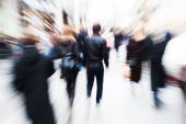 Crowd of people walking in ghte city with creative zoom effect — Stock Photo