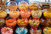 Market stall with candy bowls — Stock Photo