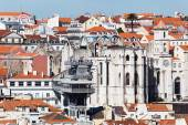 Roofs of Lisbon, Portugal, with an old church ruin, the elevator Santa Justa and unidentified people — Stockfoto