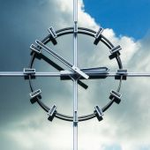 Station clock at a glass facade with reflection of the clouded sky — Stock Photo