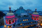 Rooftop view of Paris at night with illuminated historical buildings — ストック写真