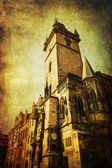 Vintage style picture of the historical tower of the historical town hall with the famous astronomical clock in the old town of Prague, Czechia — Stock Photo