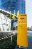 Signpost in front of the Deutsche Post Tower in Bonn, Germany — Stock Photo