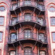 Facade of a historical warehouse building in the famous warehouse district of Hamburg, Germany — Stock Photo #56413241