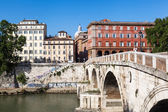 View of a Tiber bridge with the isle of Tiber in Rome, Italy — Stock Photo