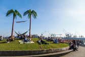 Park with artificial palms and chilling people in Hamburg, Germany — Stock Photo