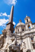 Obelisque in front of an old church at the Piazza Navona in Rome, Italy — Stock Photo