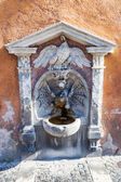 Antique drinking water fountain in Rome, Italy — Stock Photo
