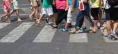 Crowd of people crossing the street at the pedestrian crossing — Stock Photo