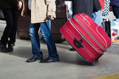 Man with a trolley bag at the railroad station — Stock Photo