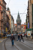 Street view of Prague, Czechia, with a historical tower at the end of the street — Stok fotoğraf