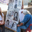 Street artist and woman on the famous Charles Bridge in Prague, Czechia — Stock Photo #57929687