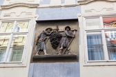 Historical relief at a house wall in the old town of Prague, Czechia — Stockfoto