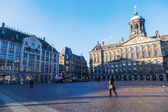 Dam Square with the Royal Palace and Madame Tussauds in Amsterdam, Netherlands — Stock Photo