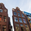 Facades of old buildings in the old town of Amsterdam, Netherlands — Stock Photo #59030411