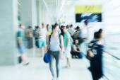 Picture with creative zoom effect of people on the move at the airport — Stock Photo