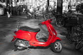 Red scooter with a black and white surrounding — Stock Photo