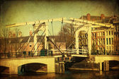 Vintage style picture of a traditional drawbridge in Amsterdam, Netherlands — Stock Photo