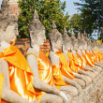 Buddha sculptures in the Buddhist Temple Wat Yai Chai Mongkon in the historical city Ayutthaya, Thailand — Stock Photo #62827819