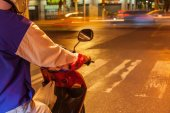 Moped rider in the night traffic — Stock Photo