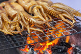 Cuttlefish on a barbecue fire at a cookshop in Bangkok, Thailand — Stock Photo