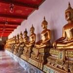 Golden Buddha statues at Wat Pho tempel in Bangkok, Thailand — Stock Photo #62970721