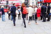Crowd of people in motion blur crossing a street in London, UK — Stock Photo