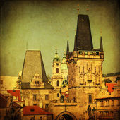 Vintage style picture of the the medieval bridge tower on the Charles Bridge in Prague, Czechia — Stock Photo