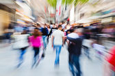 Picture of moving people in the pedestrian area of the city with zoom effect — Stock Photo