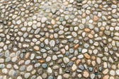 Background picture from pebbles pavement — Stock Photo