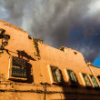 Dramatic sky over an old red walled house in Marrakesh — Stock Photo #63108233