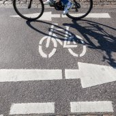 Cycle lane with markings and shades of a moving bicycle — Stock Photo