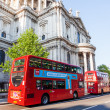 Traditional red double decker busses at the famous St. Pauls Cathedral in London, UK — Stock Photo #63117205