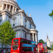 Traditional red double decker busses at the famous St. Pauls Cathedral in London, UK — Stock Photo #63118343